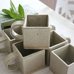 Square Stoneware Cups: These cool cups snuggle up perfectly together