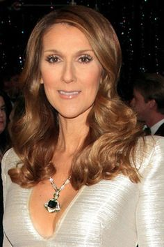 Celine Dion looks fantastic with this long, curly hairstyle. The hair starts off straight from the top with the hair starting to curl half way down. This look is romantic and very chic. For a wedding or prom, this is a very classy style.Celine's haircut is long.The hair colour is a glossy brown.