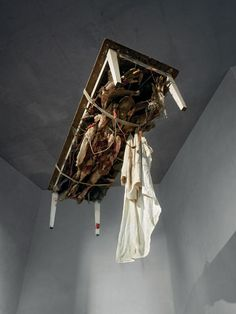 Paul Thek, Fishman in Excelsis Table, 1970−71. Mixed media: wood, latex, wax, metal, paint, fabric, string, and Styrofoam