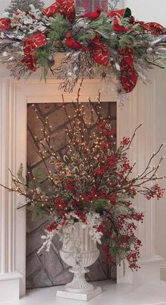 Creating Holiday Centerpieces with Lighted Branches Christmas Urns, Christmas Fireplace, Christmas Flowers, Winter Christmas, Christmas Home, Christmas Wreaths, Christmas Branches, Fireplace Mantles, Christmas Arrangements