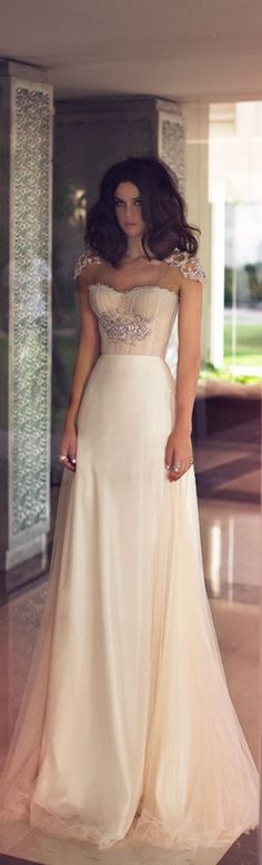 Love it minus the embellishments.  their too overstated. a small broach under the bust would be perfect.