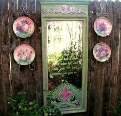 LOVE the saying on Becky Norris's garden mirror & I never thought of putting plates in a plate holder on the fence .... something else to look for at garage sales :-)