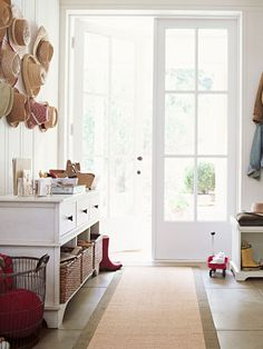 Add a table or bench with separate bins or baskets to help organize entryway clutter.