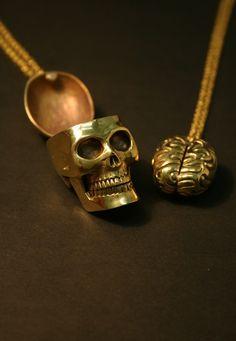 I want this sooo bad!!!! skull & brain necklaces.
