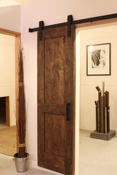 Hanging rustic sliding door - maybe for the game room?? I think yes!