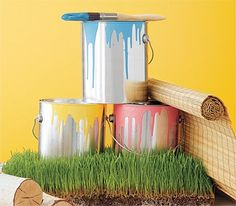 Paint cans, grass, and logs