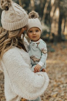 so cute! matching pom hats and cute little moose outfit. Cella Jane | A Fashion, Beauty & Lifestyle Blogger