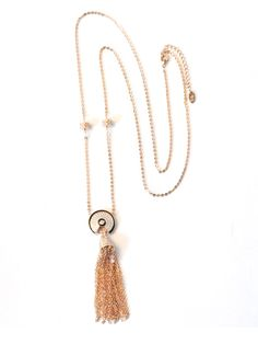 Oriental Tassel Necklace -  INR 3,699 -  This statement drop necklace features high quality golden links that holds a gorgeous pavé set pendant with glimmering golden link chain tassels. The premium 18K gold finish give this piece a lot of character making it a great addition to your wardrobe. #gold #pendant #necklace #women #fashion #trendy