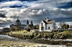 The River Corrib, Weir Lodge & The Cathedral on Nun's Island, Galway. Sky indicates the visitor's most common experience -- rain! -- OK, if you like fishing...