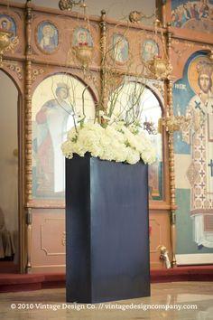 Greek Orthodox wedding ceremony altar flowers