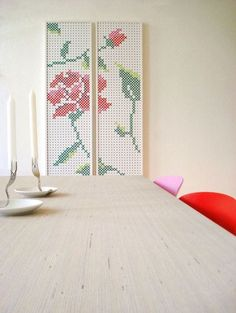 Cross stitch panels with rose design in dining room