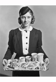 american-airlines-uniform-an-american-airlines-flight-attendant-with-a-tray-of-food-circa-1935-photo-by-pictorial-paradearchive-photosgetty-images