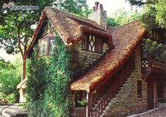 stone tudor revival cottage with thatch style roof of cedar shingles house-dreams Tudor House, Tudor Cottage, Cozy Cottage, Cottage Homes, Cottage Style, Stone Cottages, Cabins And Cottages, Stone Houses, Storybook Homes