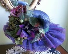 Something like this would work--in red!  Victorian Tea Party Hats | Victorian Hat Tea Party Hat by GlitzOfFlorida on Etsy