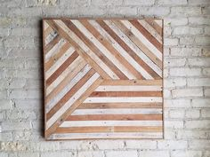 This is a one of a kind wall piece that is 30.5 inches by 30.5 inches and 1.5 inches deep. Made from reclaimed lath from the ceiling of my studio. The frame is made from the same material. It can be hung from any side you choose. This could also be used as a side table or nightstand if you add legs. It is made from reclaimed lath wood that was originally inside a plaster wall. The wood was naturally aged on one side and the other absorbed some color from the plaster. I kept the natural…