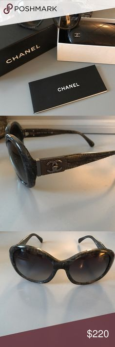 Authentic CHANEL sunglasses Comes with everything shown. Brand new, never worn. Completely 100% authentic. Plastic frames. Gray and black detail. Leather detailing on side. Super cute but they don't fit my face right. CHANEL Accessories Sunglasses