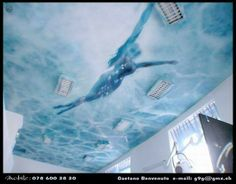 Woman in a pool, sprayed on a ceiling
