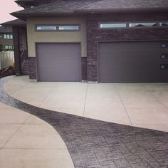 Broom finish with stamped concrete design going through driveway Stamped Concrete, Concrete Design, Stonehenge, Charcoal Color, Building A House, Garden Design, Garage Doors, New Homes, Exterior