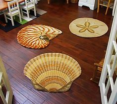Keep the sand outside where it belongs with these adorable sea shell throw rugs.