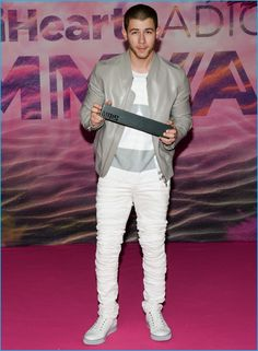 June 2016: Embracing a grey and white look, Nick Jonas poses for pictures at the iHeartRadio x MuchMusic Video Awards. The Closer singer dons a leather jacket with stacked jeans and a wide striped t-shirt from Diesel Black Gold. Jonas finished his ensemble with Lanvin sneakers.