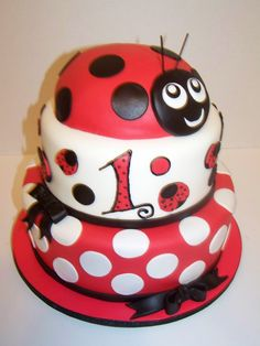 lady bug on top and K eat lady bug cake, guest others or do lady bug for her and cupcakes for others