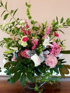 Pink, green, white arrangement.   In bloom, ltd.