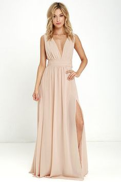 You'll be goddess-like for the entire evening in the Heavenly Hues Blush Maxi Dress! Georgette fabric drapes alongside a V-neck and back, and lays across a banded waist. Full maxi skirt has a sexy side slit. Hidden back zipper with clasp.