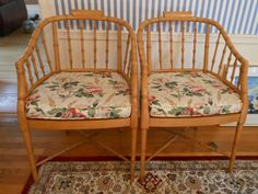 A pair of Asian-inspired faux bamboo horseshoe chairs.