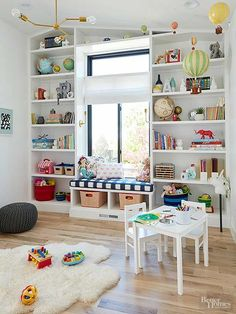 The main-floor playroom was a game-changer. The homeowners wanted to accentuate the vaulted ceiling, so they designed the shelves directly into the ceiling pitch along with a window seat for added storage. games for kids ideas Playroom Storage, Playroom Design, Kids Room Design, Playroom Decor, Playroom Ideas, Bedroom Storage, Kids Room Shelves, Book Shelves, Wall Storage