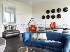 Google Image Result for http://www.narratives.co.uk/ImageThumbs/DP024_02/3/DP024_02_Modern_art_installation_and_blue_sofa_in_living_room_of_contemporary_Bath_home__Somerset__England__U.jpg