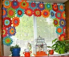 Crocheted flowers for kitchen window. Cute