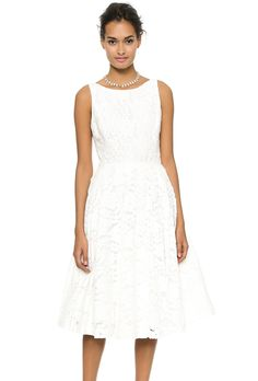 "Brides.com: 37 Little White Dresses You Can Buy Right Now. ""Zack"" lace mid-calf dress, $596, Alice + Olivia available at ShopBop  See more tea-length wedding dresses."
