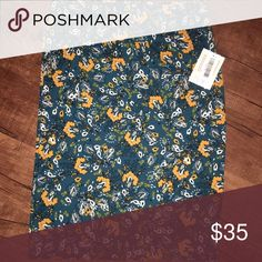 LuLaRoe Cassie Skirt XL Brand new with tags attached this is a LuLaRoe Cassie skirt size xl can be worn as a top, infinity scarf and skirt of course. Offers welcome LuLaRoe Skirts Pencil