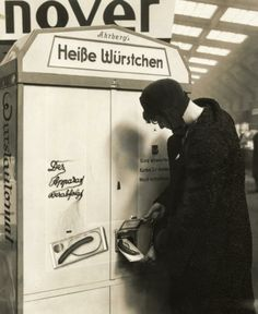 1931: Slot machine selling warm sausages in Germany