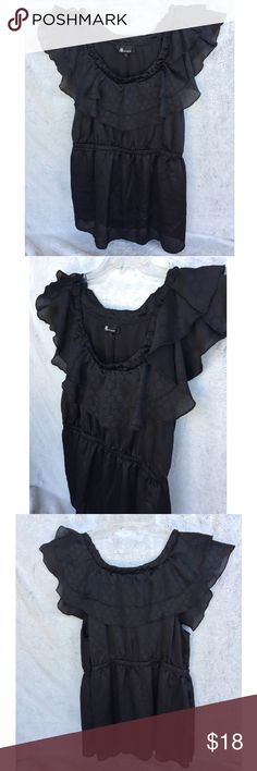 Black Ruffle Blouse Pretty black blouse can be worn to work or out to dinner. Subtle polka dot print.   ✔️If you'd like to MAKE AN OFFER please do so through the offer button ONLY. I won't negotiate prices in the comments.  ✔️All sale items, items $15 and under, & clearance items are firm unless BUNDLED.  ❌No trades, PayPal, Holds Instagram: @lovelionessie Tops Blouses