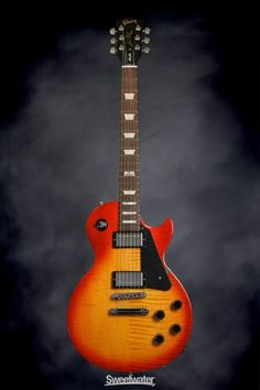 Only at Sweetwater! ✅ Inspection and ✅ Financing for your Gibson SG Standard Heritage Cherry! Gibson Les Paul Studio, Guitar Collection, Gibson Guitars, Beautiful Guitars, Cherry, Electric, Candy, Thesis, Bass