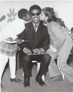 Stevie Wonder with some fans.