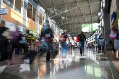 Passengers walk through the food court in Barbara Jordan Terminal at ABIA - Austin Bergstrom International Airport.