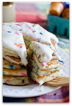 Birthday Cake Pancakes ~ 1 1/2 cups all-purpose flour 1 cup yellow cake mix 1 tbsp sugar 1 tsp baking powder 1/2 teaspoon baking soda 1/4 tsp salt 2 eggs 1 1/2 cups buttermilk 1/2 cup milk 2 Tablespoons butter, melted 1 tsp vanilla extract 1/3 cup (1.75 oz) sprinkles | Whipping cream Powdered sugar