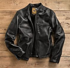 "Schott Leather Jacket Founded in a Lower East Side basement in 1913, Schott NYC is one of the great American leather and motorcycle apparel companies. One of the first to equip a coat with the newfangled closure called the ""zipper,"" they outfitted WWII fly boys and Hollywood rebels (including James Dean and Marlon Brando). And in the '70s and '80s Schott's Perfecto® motorcycle jacket was the uniform of punk rock icons from the Ramones to the Sex Pistols"