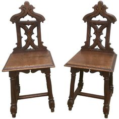 A fine pair of English oak hall chairs with Gothic tracery back splats topped by incised trefoil decoration, supported by four turned legs joined by stretchers with chamfered edges. Furniture Repair, New Furniture, Hall Chairs, Side Chairs, Throne Chair, Mid Century Armchair, Tapestry Design, Chairs For Sale, Victorian Homes