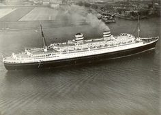 Holland America Line NIEUW AMSTERDAM in the Maas river on the way to Rotterdam after acceptance by the line, April 23, 1938