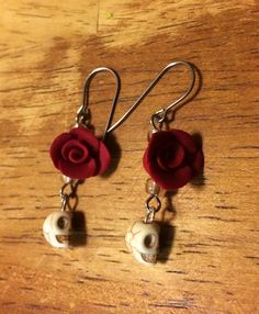 These pretty little gems are both elegant and fun! The hand made polymer roses add a touch of sophistication to this pair of skull earrings.