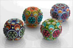 Colorful beads by Dustin Tabor. http://www.southernflames.org/Class%20Lottery%20Info%20and%20Forms/Bio%202007%201%20Dustin%20Tabor.htm