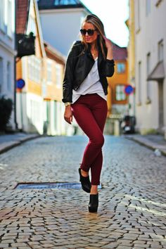 Wine colored jeans & leather jacket.