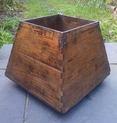 "Antique 19th to early 20th Century Chinese wooden grain measure called ""Sheng"" (升). The vessel is in pyramid shape and made of heavy hard wood re-enforced with metal sheet on the corners and ridges with traditional flat head iron nails."