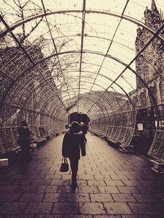 random woman walking through the light tunnel. #norwich #christmas #portrait #photography