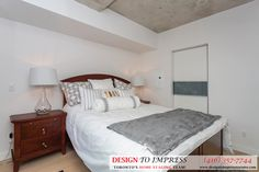 Master bedroom in Downtown Toronto, staged to sell for a high ROI via Toronto's home staging company, Design to Impress!