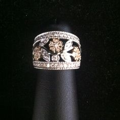 Custom made white and yellow gold diamond flower ring