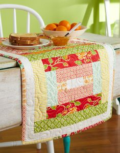 "Free pattern - Strippy and Bright Table Runner using 2 1/2"" strips.  Also shown in the Winter 2012 - Quilts and More magazine"